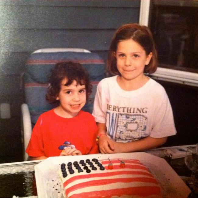 Me and my sister, Kerry, in front of the July 4th cake my mom made. I can still taste the cake even now in  my mind.